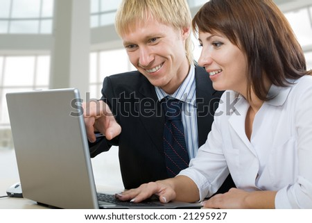 Two business people using laptop - stock photo