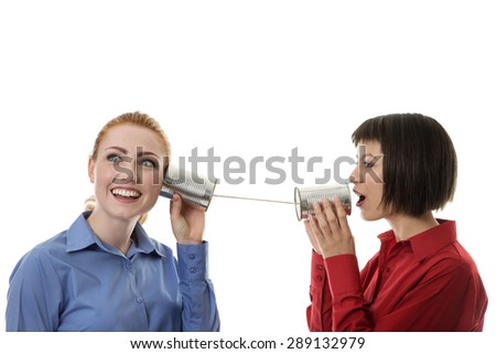 two business people using tin cans to communicate with each other - stock photo