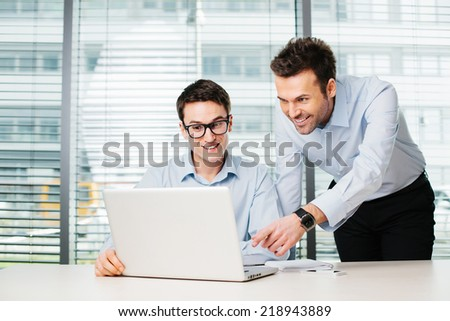 Two business people working in office - stock photo