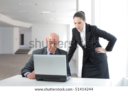 Two business people working on a laptop