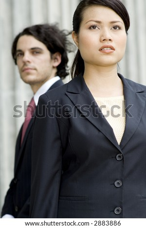 Two business professionals looking ahead (shallow depth of field used)