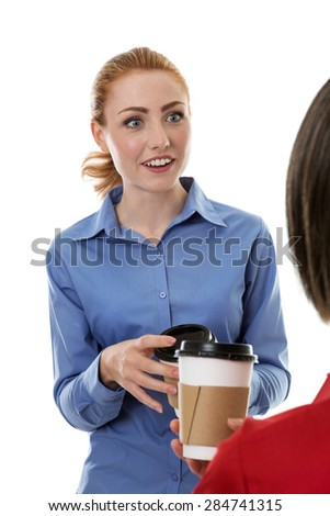two business woman chatting and gossiping over a coffee - stock photo