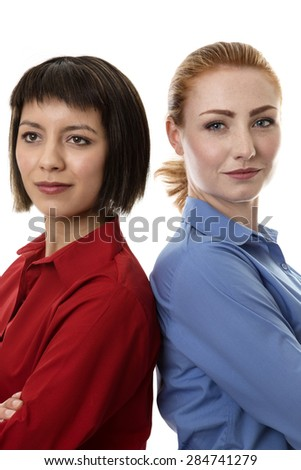 two business woman standing back to back