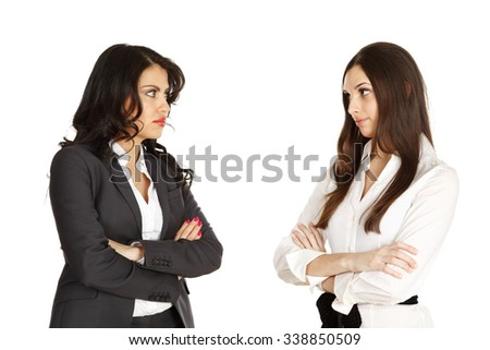 Two business woman with arms crossed. Looking at each other with mistrust