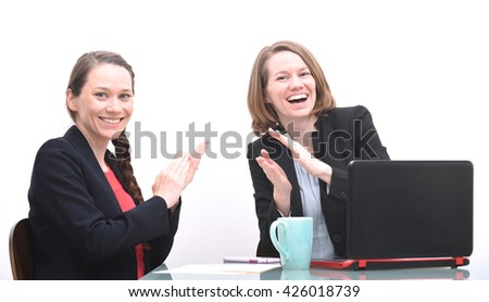 Two business women clapping while at business meeting - stock photo