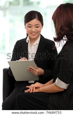 Two business women having a meeting - stock photo