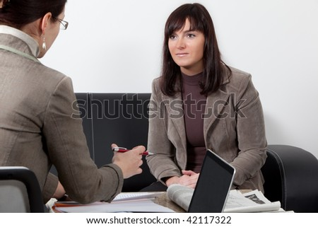 two business women having a meeting at the office