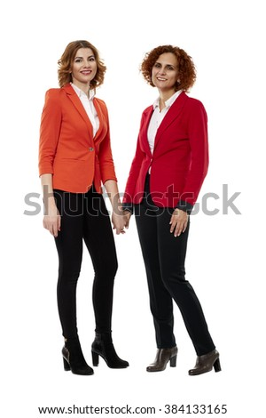 Two business women in full length on white background