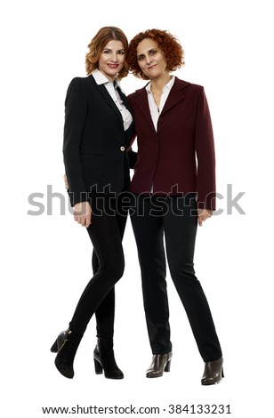Two business women in full length on white background - stock photo