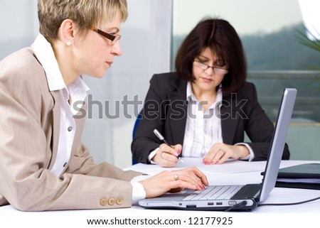 two business women working in the office
