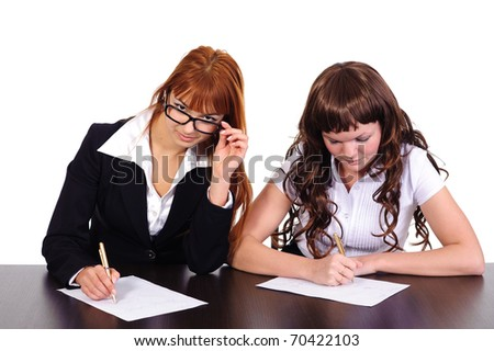 Two business women working together at office, isolated on white
