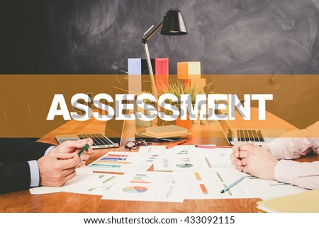Two Businessman Assessment working in an office - stock photo