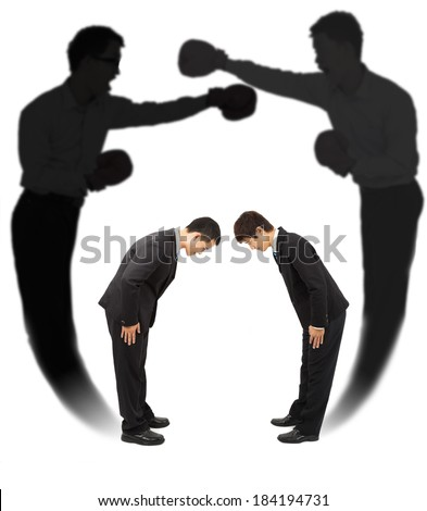 Two businessman bow each other with fighting shadow