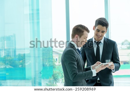 Two businessman dicussing business in office - stock photo