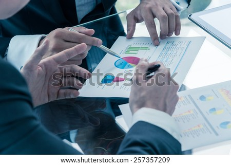 two businessman discussing business performance - stock photo