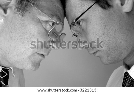 Two businessman from different generations. Conflict of powers. - stock photo