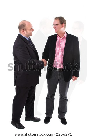 Two businessman having just come to an agreement and shaking each other's hand on the deal