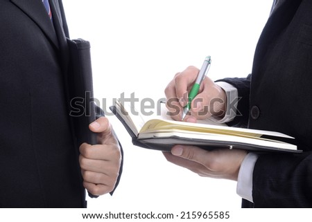 Two businessman holding business book and sign with the pen