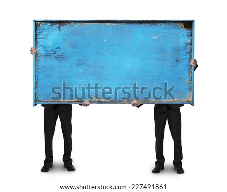 two businessman holding old blue blank wooden billboard isolated on white background - stock photo