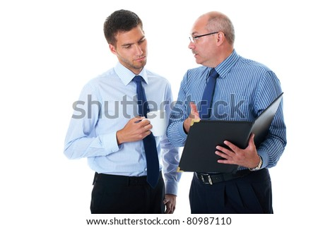 two businessman in blue shirts check and discuss their documents, isolated on white - stock photo