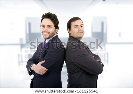 Two Businessman posing back to back together