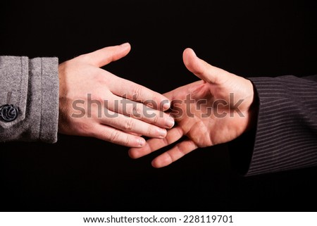 Two businessman ready to shaking hands - stock photo