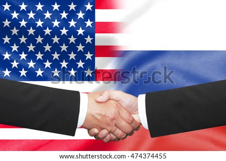 two businessman shakehand over half america half russian flag