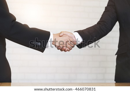 two businessman shaking hands - business teamwork, cooperation concept