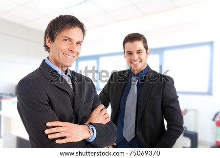 Two businessman sharing an office - stock photo