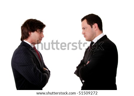two businessman standing face to face, isolated  on white background. Studio shot - stock photo