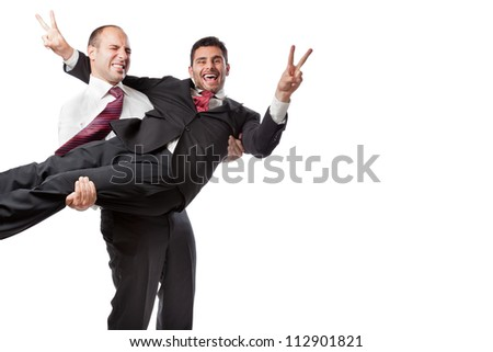 Two Businessman standing on a white background and carrying heavy boxes - stock photo