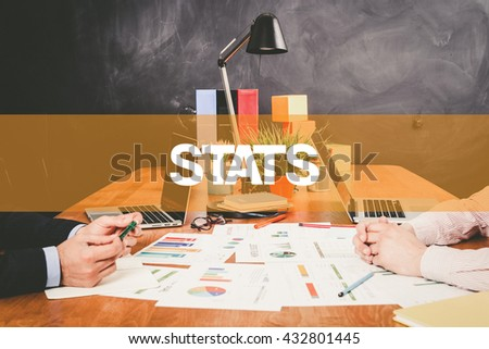 Two Businessman Stats working in an office - stock photo