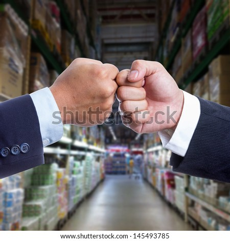 Two Businessman touching hand for coordination work - stock photo