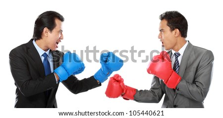 Two businessman with boxing glove ready to fight - stock photo