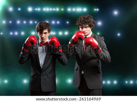 Two businessman with boxing gloves in the ring - stock photo