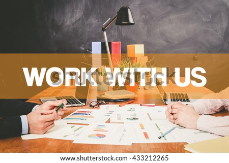 Two Businessman Work With Us working in an office - stock photo