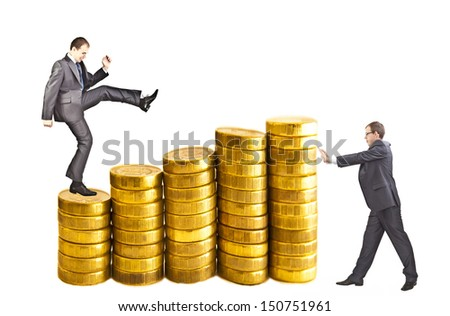 Two Businessmans - one climbing gold coins stacks  isolated on white background other is pushing and trying to shift the money supply - the golden capital