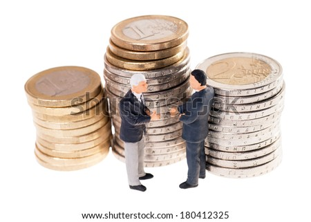 two businessmen and euro coins isolated over a white background / businessman - stock photo