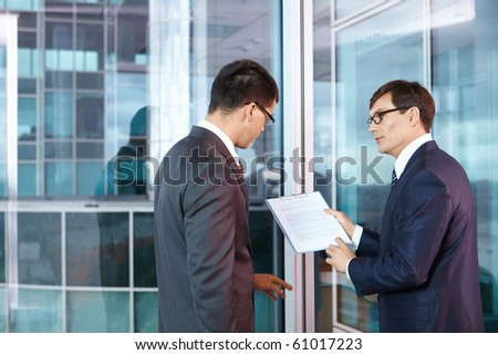 Two businessmen are discussed in the office - stock photo