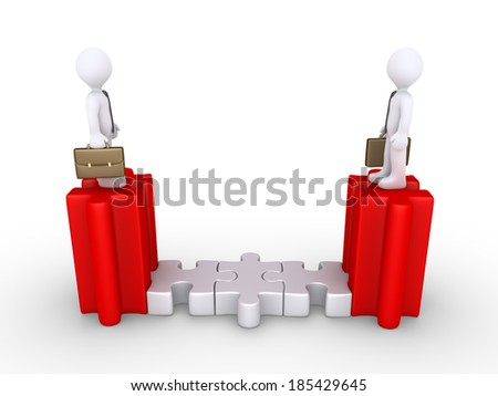 Two businessmen are standing high on connected puzzle pieces - stock photo