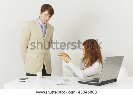Two businessmen at office during a lunch break - stock photo