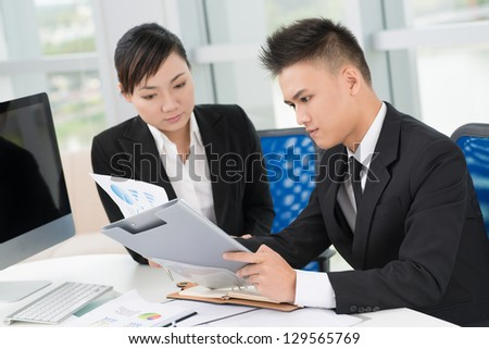 Two businessmen at working process - stock photo