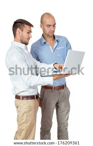 Two businessmen consulting a landheld laptop computer as they hold a discussion about the information on the screen, isolated on white