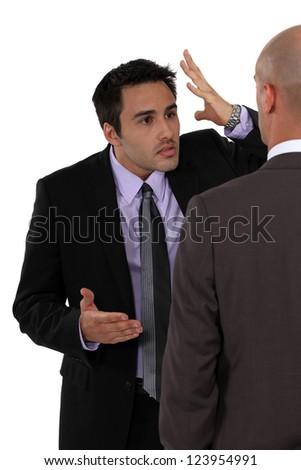 Two businessmen disagreeing - stock photo