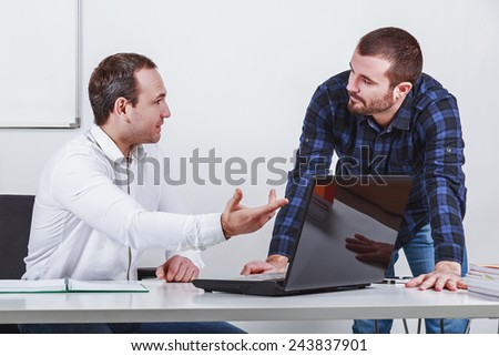 Two businessmen  discuss at meeting in office - stock photo