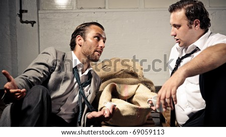 two businessmen discuss the coffee and drink espresso together - stock photo