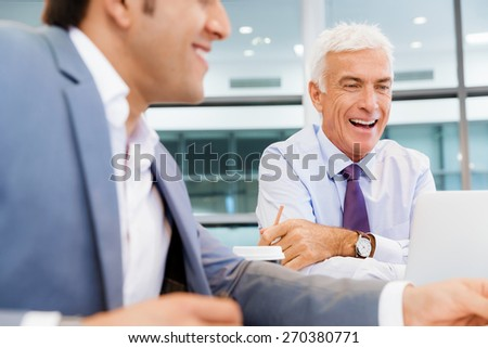 Two businessmen discussing their business in office - stock photo