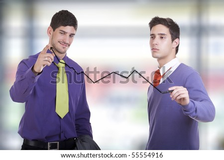 Two businessmen drawing a graph in the office. - stock photo