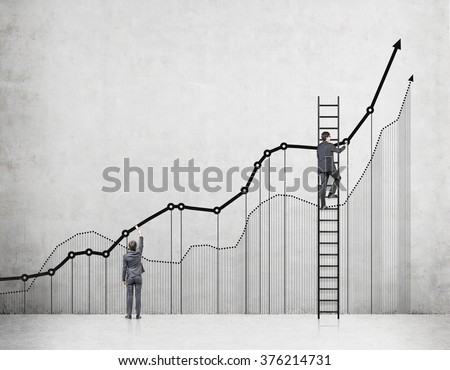Two businessmen drawing graphs on a concrete wall, one of them on a ladder. Back view. Concrete background. Concept of analysing information. - stock photo
