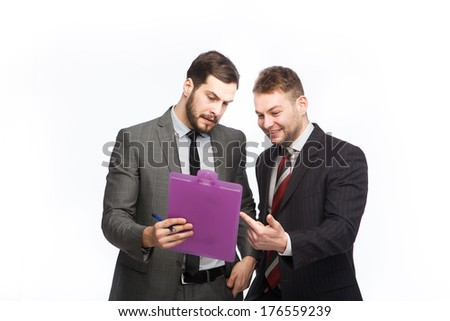 two businessmen examines a clipboard on white background - stock photo